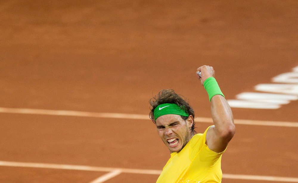 Rafael Nadal from Spain celebrates after winning his match against Roger Federer from Switzerland during the semifinal in the Madrid Open Tennis tournament in Madrid, Saturday, May 7, 2011.