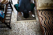 SYRIA - Al Qsair. A Syrian reporter prays after one day of work, on January 27,  2012. Al Qsair is a small town of 40000 inhabitants, located 25Km south-west of Homs. The town is besieged since the beginning of November and so far it counts 65 dead.In all Syria there are hundreds of non-professional reporters who without experience and without proper gear keep documenting, day after day, the crackdown of the regime. This series of pictures is dedicated to them... to this colleagues who among every kind of difficulties and risks let know to the word their stories and drama.  ALESSIO ROMENZI