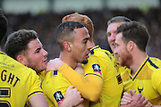 Oxford United midfielder Kemar Roofe celebrates with team mates after his goal during the The FA Cup third round match between Oxford United and Swansea City at the Kassam Stadium, Oxford, England on 10 January 2016. Photo by Jemma Phillips.