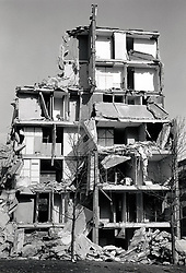 Demolition of Balloon Woods housing estate, Wollaton, Nottingham UK 1984. Built in late 1960s, the flats leaked& reinforcement corroded. Soon after the first tenants moved in, they were complaining of damp and mould. Paper pealed off the walls, electric sockets came loose, and appliances couldn't be used for fear of electrocution.