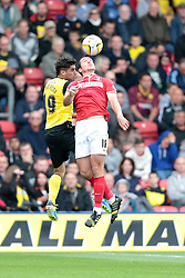 Charlton Athletic's Yann Kermorgant and Watford's Marco Davide Faraoni challenge for the ball  - Photo mandatory by-line: Nigel Pitts-Drake/JMP - Tel: Mobile: 07966 386802 14/09/2013 - SPORT - FOOTBALL -  Vicarage Road - Hertfordshire - Watford V Charlton Athletic - Sky Bet Championship