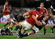 David Wallace of the Lions is tackled by Patric Cilliers and Craig Burden of the Sharks. <br /> Rugby - 090610 - British&Irish Lions v Sharks - ABSA Stadium - Durban - South Africa. The Lions won 37 -3.<br /> Photographer : Anton de Villiers / SASPA