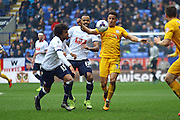 Bolton Defender Derik Osede challenges Preston North End Striker Callum Robinson during the Sky Bet Championship match between Bolton Wanderers and Preston North End at the Macron Stadium, Bolton, England on 12 March 2016. Photo by Pete Burns.