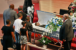 03 June 2014. New Orleans, Lousiana. <br /> Mother and siblings attend the funeral for teenage shooting victim Dwayne Matthew Joseph at the Franklin Avenue Baptist Church. 17 year old Joseph was shot and killed following an altercation in the street May 26th. Raised by his great grandmother Catherine Robinson, family and friends confirmed Dwayne was a good kid who went to church, looked after his younger siblings and had never been in trouble with the law. Dwayne's older brother Damien preceded him in death. He too was shot dead in February 2011 aged just 19 years.<br /> Photo; Charlie Varley/varleypix.com