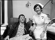 Barry  McGann, Rugby International   (K81)..1977..13.01.1977..01.13.1977..13th January 1977..Following a training ground accident at the 'Ireland Team Trial' Barry McGann was admitted to St Vincents Nursing Home, Merrion Road, Dublin, for treatment and recuperation..Image of Barry McGann being comforted by Nurse M. Hoban, Sister in Charge,St Vincents at his bedside.