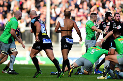 Tom O'Flaherty of Exeter Chiefs attempts to keep playing after taking off his shirt as Gabriel Ibitoye of Harlequins keeps hold of it during a ruck - Mandatory by-line: Ryan Hiscott/JMP - 19/10/2019 - RUGBY - Sandy Park - Exeter, England - Exeter Chiefs v Harlequins - Gallagher Premiership Rugby