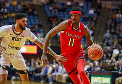 Jan 2, 2019; Morgantown, WV, USA; Texas Tech Red Raiders forward Tariq Owens (11) drives past West Virginia Mountaineers forward Esa Ahmad (23) during the first half at WVU Coliseum. Mandatory Credit: Ben Queen-USA TODAY Sports