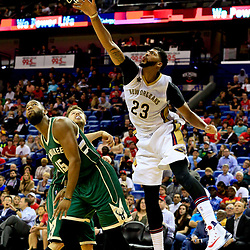 Nov 1, 2016; New Orleans, LA, USA; New Orleans Pelicans forward Anthony Davis (23) shoots as he is fouled by Milwaukee Bucks center Greg Monroe (15) during the third quarter of a game at the Smoothie King Center. Mandatory Credit: Derick E. Hingle-USA TODAY Sports