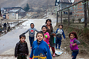 """Children playing on the street at the Roma part of the district """"Podsadek"""". The city of Stara Lubovna is located about 100 km from Kosice in northeast Slovakia. The town has a population of 16350, of whom 2 060 (13%) are of Roma origin. The majority of Roma live in the Podsadek district, where 980 (74%) out of 1330 inhabitants are Roma."""