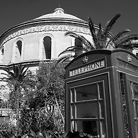 Red phonebox outside the Dome,<br /> Mosta Dome Church,<br /> Malta, Europe.<br /> Summer 2016.