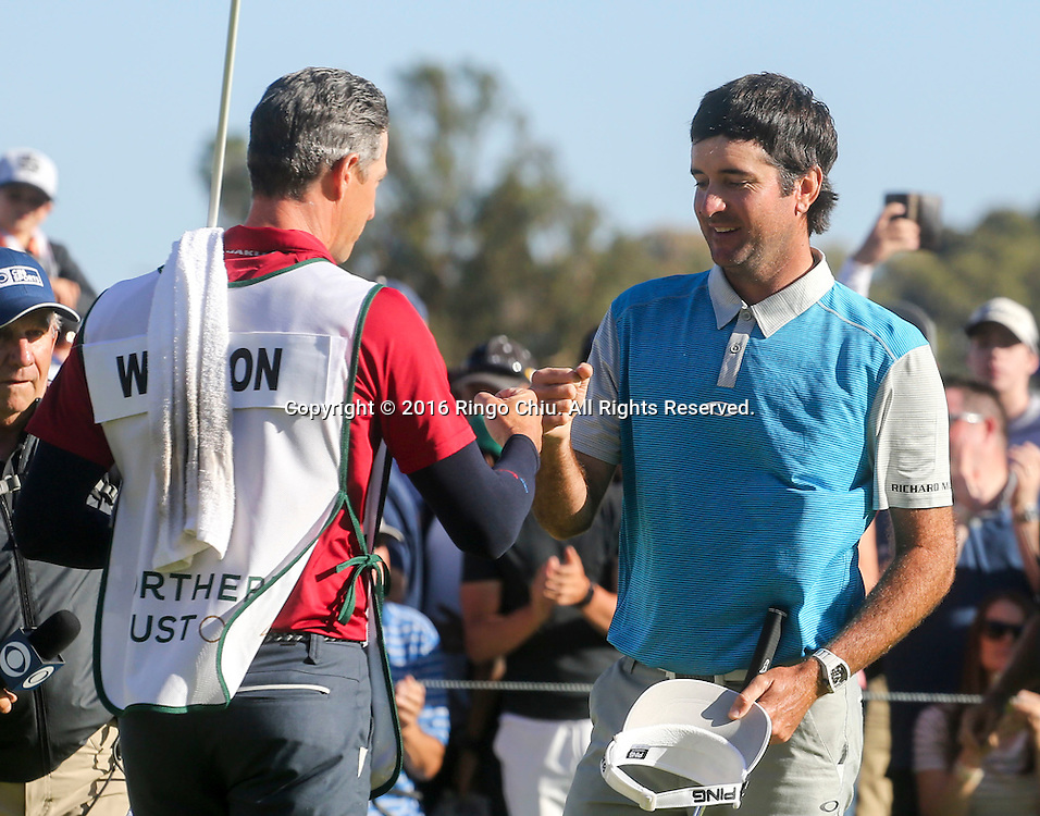 Bubba Watson celebrates with his caddie Ted Scott after winning on the final round of the PGA Tour Northern Trust Open golf tournament at Riviera Country Club on February 21, 2016, in Los Angeles. Bubba Watson won the Northern Trust Open.(Photo by Ringo Chiu/PHOTOFORMULA.com)<br /> <br /> Usage Notes: This content is intended for editorial use only. For other uses, additional clearances may be required.