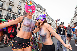 © Licensed to London News Pictures. 06/07/2019. LONDON, UK.  Women in the crowd celebrate. Tens of thousands of visitors, many wearing eye-catching costumes, gather to watch and take part in the annual Pride in London Parade, the largest celebration of the LGBT+ community in the UK.  This year's event also celebrates 50 years since the birth of the modern LGBT+ rights movement. Photo credit: Stephen Chung/LNP