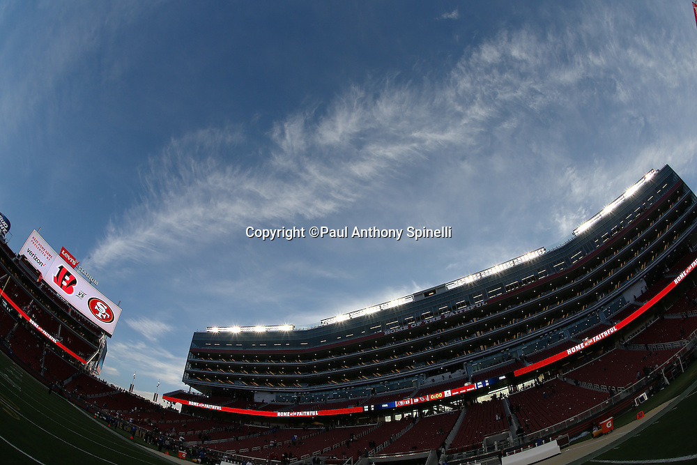 The sky shows trails of white clouds framed by a blue sky in this photograph taken from the interior Levi's Stadium after the San Francisco 49ers 2015 week 12 regular season NFL football game against the Arizona Cardinals on Sunday, Nov. 29, 2015 in Santa Clara, Calif. The Cardinals won the game 19-13. (©Paul Anthony Spinelli)