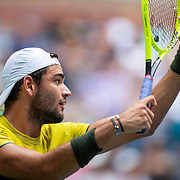 2019 US Open Tennis Tournament- Day Ten.  Matteo Berrettini of Italy serving against Gael Monfils of France in the Men's Singles Quarter-Finals match on Arthur Ashe Stadium during the 2019 US Open Tennis Tournament at the USTA Billie Jean King National Tennis Center on September 4th, 2019 in Flushing, Queens, New York City.  (Photo by Tim Clayton/Corbis via Getty Images)