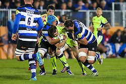 AJ MacGinty of Sale Sharks is tackled by Zach Mercer and Elliott Stooke of Bath Rugby - Rogan Thomson/JMP - 07/10/2016 - RUGBY UNION - The Recreation Ground - Bath, England - Bath Rugby v Sale Sharks - Aviva Premiership.