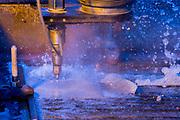 Water jet cutting steel sheet