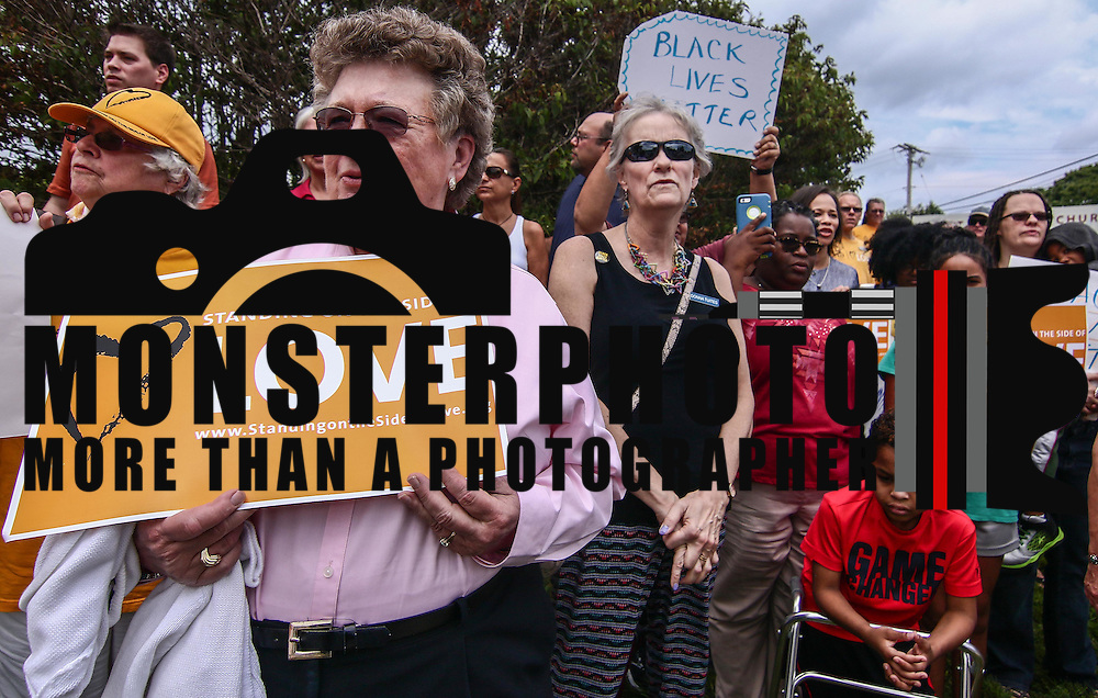 """Members of the First Unitarian Church congregation hold  signs that reads """"Standing On The Side Of Love"""" during a rededication ceremony Sunday, August 21, 2016, at First Unitarian Church in Wilmington."""