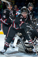 KELOWNA, CANADA -FEBRUARY 5: Haydn Fleury D #4 of the Red Deer Rebels reaches for the puck against the Kelowna Rockets on February 5, 2014 at Prospera Place in Kelowna, British Columbia, Canada.   (Photo by Marissa Baecker/Getty Images)  *** Local Caption *** Haydn Fleury;