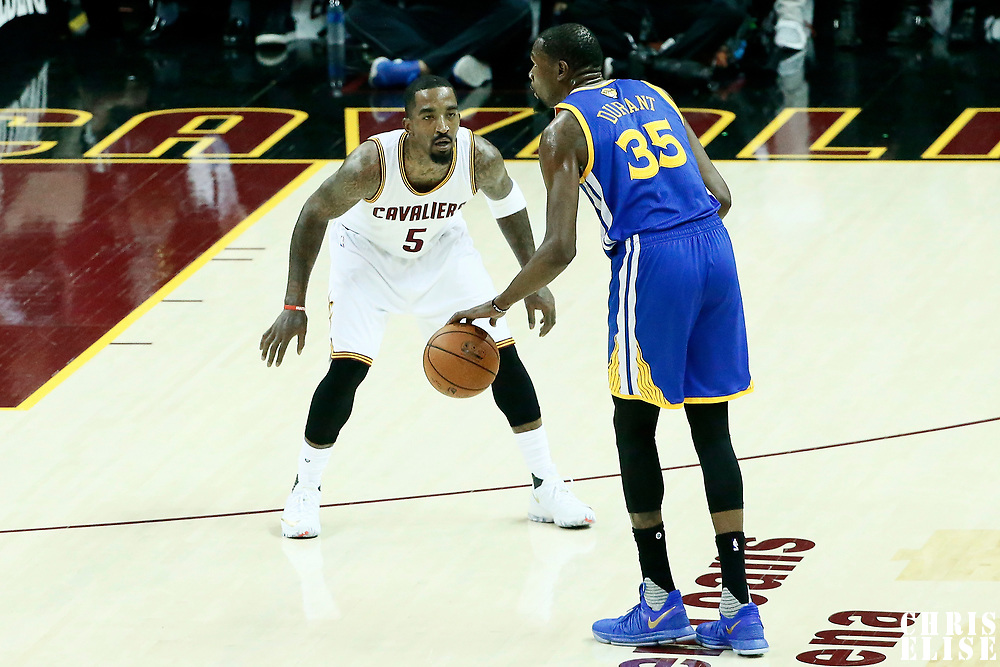 09 June 2017: Cleveland Cavaliers guard JR Smith (5) defends on Golden State Warriors forward Kevin Durant (35) during the Cleveland Cavaliers 137-11 victory over the Golden State Warriors, in game 4 of the 2017 NBA Finals, at  the Quicken Loans Arena, Cleveland, Ohio, USA.