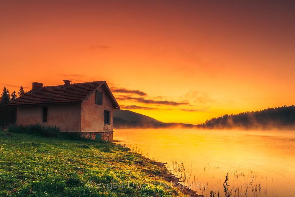 Small house on the lake coast
