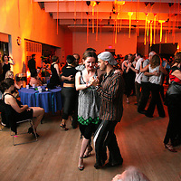 Couples dance close embrace Argentine Tango at an all-night milonga at the annual Tango de los Muertos festival in Boston.