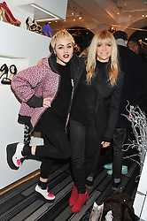 Left to right, JAIME WINSTONE and JO WOOD at a party to celebrate the launch of a limited edition shoe The Chambord in celebration of Nicholas Kirkwood's partnership with Chambord black raspberry liqueur, held at the Nicholas Kirkwood Boutique, 5 Mount Street, London on 12th December 2012.