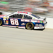 "Dale Earnhardt Jr. (88) speeds down the straight away during NASCAR SPRINT CUP ""AAA 400″ auto race at Dover International Speedway in Dover, DE Sunday,  Sept  29, 2013"