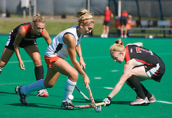 Maryland Terrapins Back Emma Thomas (7) knocks the ball away from Virginia Cavaliers forward Kaitlyn Hiltz (7).  The #1 ranked Maryland Terrapins defeated the #10 ranked Virginia Cavaliers 4-3 in overtime in NCAA Field Hockey at the Turf Field on the Grounds of the University of Virginia in Charlottesville, VA on October 4, 2008.
