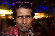 Man at the night market, Arpora, Goa