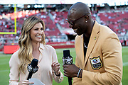 FOX Sports sideline reporter Erin Andrews has a laugh with former San Francisco 49ers wide receiver and newly inducted member of the Pro Football Hall of Fame Terrell Owens on the sideline before the San Francisco 49ers NFL week 9 regular season football game against the Oakland Raiders on Thursday, Nov. 1, 2018 in Santa Clara, Calif. The 49ers won the game 34-3. (©Paul Anthony Spinelli)
