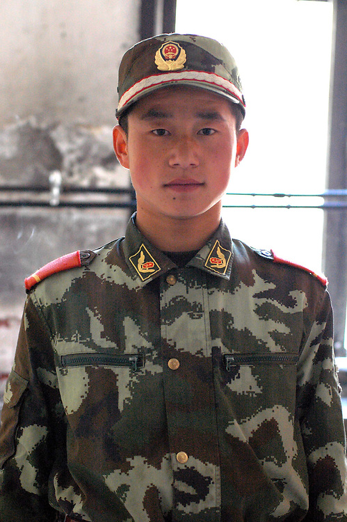 A Chinese soldier on a break in Dege - March 22, 2008 - Michael Benanav