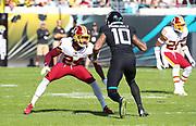 Dec 16, 2018; Jacksonville, FL, USA; Washington Redskins cornerback Josh Norman (24) covers Jacksonville Jaguars wide receiver Donte Moncrief (10) during an NFL game at TIAA Bank Field. The Redskins beat the Jaguars 16-13. (Steve Jacobson/Image of Sport)