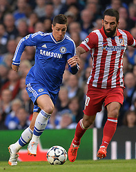 30.04.2014, Stamford Bridge, London, ENG, UEFA CL, FC Chelsea vs Atletico Madrid, Halbfinale, Rueckspiel, im Bild Chelsea's forward Fernando Torres and Athletico Madrid's midfielder Arda Turan compete for the ball // Chelsea's forward Fernando Torres and Athletico Madrid's midfielder Arda Turan compete for the ball during the UEFA Champions League Round of 4, 2nd Leg Match between Chelsea FC and Club Atletico de Madrid at the Stamford Bridge in London, Great Britain on 2014/05/01. EXPA Pictures &copy; 2014, PhotoCredit: EXPA/ Mitchell Gunn<br /> <br /> *****ATTENTION - OUT of GBR*****