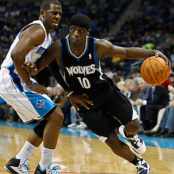February 7, 2011; New Orleans, LA, USA; Minnesota Timberwolves point guard Jonny Flynn (10) drives past New Orleans Hornets point guard Chris Paul (3) during the third quarter at the New Orleans Arena. The Timberwolves defeated the Hornets 104-92.  Mandatory Credit: Derick E. Hingle