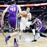 06 March 2017: Denver Nuggets forward Danilo Gallinari (8) drives past Sacramento Kings guard Ty Lawson (10) and Sacramento Kings center Kosta Koufos (41) during the Denver Nuggets 108-96 victory over the Sacramento Kings, at the Pepsi Center, Denver, Colorado, USA.