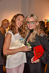 Zoe Buckman and Fru Throlstrup at a VIP private view of 21st Century Women held at Unit London, Hanover Square, London England. 03 October 2018.