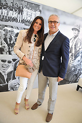 CAMILLA MABBOTT and JON ZAMMETT of Audi at the St.Regis International Polo Cup between England and South America held at Cowdray Park, West Sussex on 18th May 2013.  South America won by 11 goals to 9 goals.
