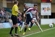 James Pearson of Barnet FC battles with Wycombe Wanderers defender Michael Harriman (19) during the Sky Bet League 2 match between Wycombe Wanderers and Barnet at Adams Park, High Wycombe, England on 16 April 2016. Photo by Dennis Goodwin.