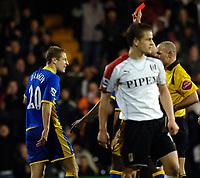 Photo: Daniel Hambury.<br />Fulham v Tottenham Hotspurs. Barclays Premiership. 31/01/2006.<br />Tottenham's Michael Dawson is shown the red card.