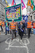 On your bike. The NUT leads a national strike action in England and Wales. Marches and rallies are being held around the country, including this one from Broadcasting House to Downing Street, Whitehall. The union says the action is being taken against: Excessive workload and bureaucratic; Performance related pay and in defence of a national pay scale system; Unfair pension changes. Christine Blower (pictured with sun glasses), General Secretary of the National Union of Teachers, the largest teachers&rsquo; union said: &ldquo;Teachers deeply regret the disruption caused by this strike action to parents and teachers. The Government&rsquo;s refusal, however, to engage to resolve the dispute means that we have no alternative other than to demonstrate the seriousness of our concerns.<br /> &ldquo;Teachers&rsquo; levels of workload are intolerable &ndash;the Government&rsquo;s own survey, published last month, shows that primary school teachers work nearly 60 hours a week and secondary school teachers work nearly 56 hours a week. 2 in 5 teachers are leaving the profession in the first 5 years of teaching as are many others.  This is bad for children and bad for education. London, UK 26 March 2014.<br />  Guy Bell, 07771 786236, guy@gbphotos.com