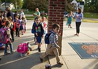 Mixed emotions as kindergarten students enter Elm Street Elementary School on Thursday morning.  (Karen Bobotas/for the Laconia Daily Sun)