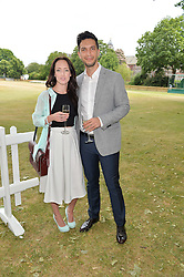 ADAM McNAB and HOLLY COOPER at the Flannels For Heroes cricket competition in association with Dockers held at Burton Court, Chelsea, London on 19th June 2015