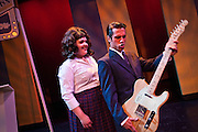"Lindsey Hedberg, left, playing the role of Tracy Turnblad, swoons over Michael Tramontin as Link Larkin playing his electric guitar during the Coeur d'Alene Summer Theatre's production of ""Hairspray"" on Tuesday. The show will premiere at North Idaho College's Boswell Hall Schuler Performing Arts Center at 7:30pm on August 7th."