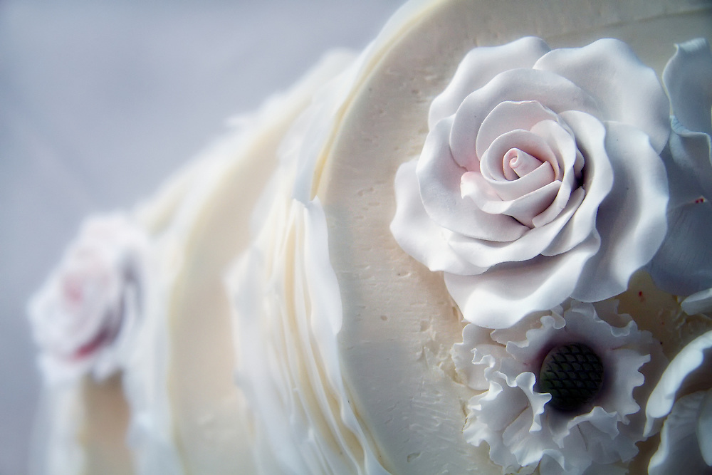 Floral icing detail of wedding cake.
