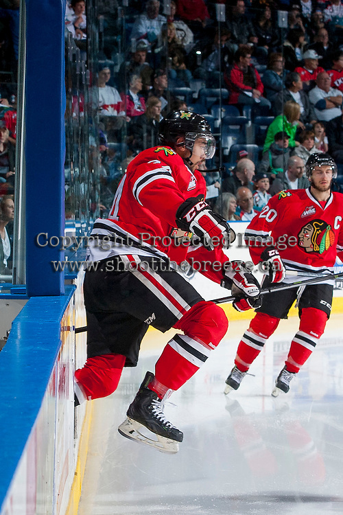 KELOWNA, CANADA - APRIL 25: Mathew Dumba #24 of the Portland Winterhawks enters the ice against the Kelowna Rockets on April 25, 2014 during Game 5 of the third round of WHL Playoffs at Prospera Place in Kelowna, British Columbia, Canada. The Portland Winterhawks won 7 - 3 and took the Western Conference Championship for the fourth year in a row earning them a place in the WHL final.  (Photo by Marissa Baecker/Getty Images)  *** Local Caption *** Mathew Dumba;