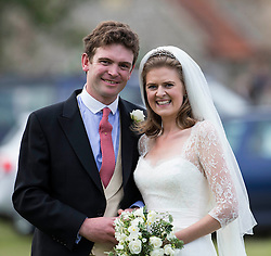 The Bride and Groom -James Meade and Lady Marsham the daughter of Earl of Romney in Gayton, Norfolk, United Kingdom. Saturday, 14th September 2013. Picture by i-Images