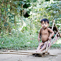 A Batak child in a makeshift trailer