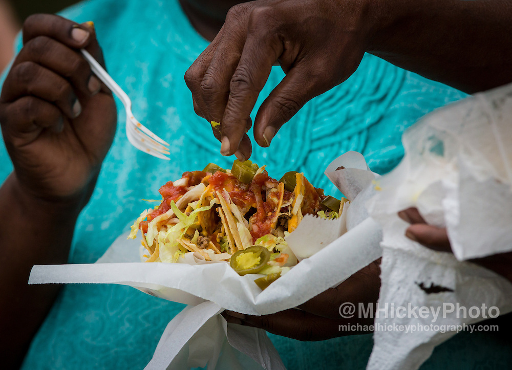 Festival patrons eat loaded nachos at festival in Kokomo, Indiana.