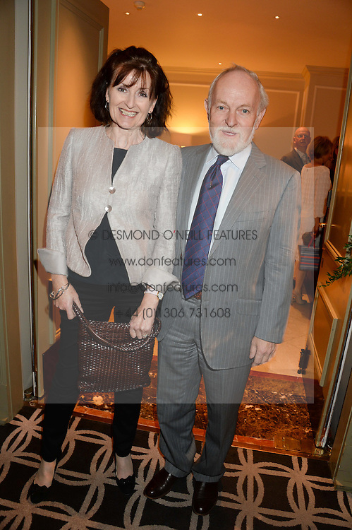 SIR RICHARD & LADY STILGOE at the 90th birthday party for Nicholas Parsons held at the Hyatt Churchill Hotel, Portman Square, London on 8th October 2013.