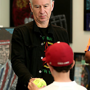 March 13, 2016, Palm Springs, CA:<br /> John McEnroe signs autographs in the Mike Sullivan art booth during the 2016 BNP Paribas Open at the Indian Wells Tennis Garden in Indian Wells, California Sunday, March 13, 2016.<br /> (Photos by Billie Weiss/BNP Paribas Open)